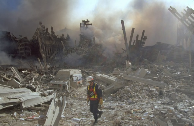 Ambulance at WTC, approximately the height of debris pile!