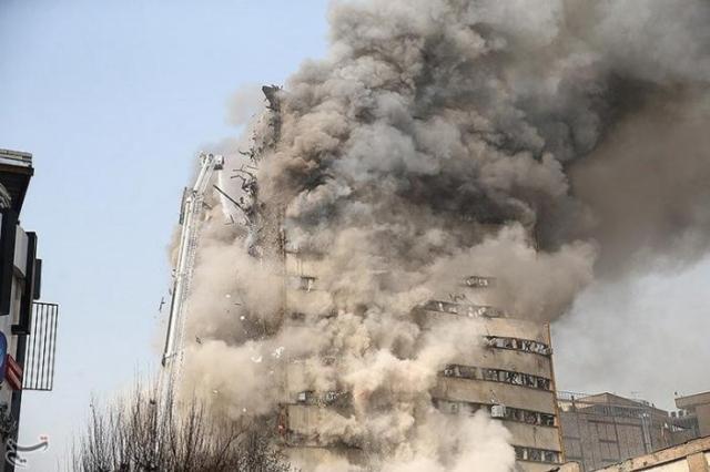 Smoke rises from a blazing high-rise building in Tehran, Iran January 19, 2017. Tasnim News Agency/Handout via REUTERS